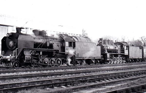 UKRAINE - SO17-4371 and EM735-72 - 3049 Class S017 2-10-2 built by Kharkov, Bryansk, Voroshilovgrad, Krasnoyarsk and Ulan-Ude Locomotive Works. from 1934 to 1951 with light axle loading - Class EM 0-10-0 - built from 1912 by Lugansk Locomotive Works - seen here at Kamanets Podolskiy on LCGB Special in October 1996.