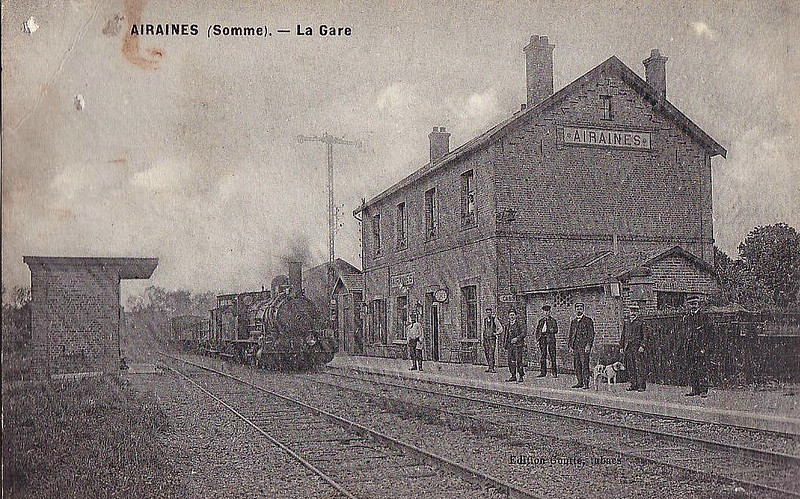 AIRAINES - A small town on the Somme, about 20km north west of Amiens. For such a small station, it seems to have a very large staff. I think even the 0-6-0 on the freight train is posing for it's photo! Sorry about the poor quality of the can but the postcard is also poor quality.