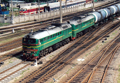 LG - 2M62 0180 - 74 'Double Sergei' locomotives built by Lugansk from 1976 - heads north through Vilnius with a train of tankers, 28/08/06.