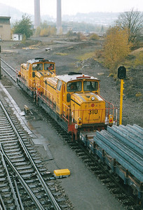 INDUSTRIAL - ARBED - 310/313 - 19 Bo-Bo heavy shunters built 1966 by MaK, fitted for ground control, taken over by CFL subsequently - now with humans in the cab as they venture out onto the steelworks' mainline, 29/10/03.