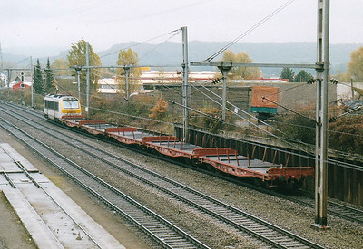 CFL - 3011 - 20 Class 3000 dual-voltage engines built  from 1999, similar to SNCB Class 1300 - heads east past Belval Usines on a short train of steel empties, 29/10/03.