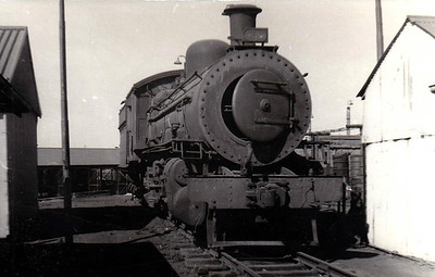SOUTH AFRICA - SAR -  942 - Class 11 2-8-2 - built 1904 by North British Loco Co. as CSAR No.730 - all withdrawn by 1975 - preserved plinthed at Witbank Station - seen here dumped on Witbank Shed, 05/73.