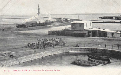 EGYPT - PORT TEWFIK RAILWAY STATION - a fairly basic affair, with no discernable platforms and few facilities, in about 1905. If the train approaching along the embankment is en route to the station, then there must be a very sharp curve on the extreme left of the picture.