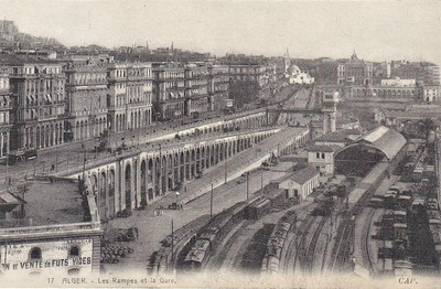 ALGERIA - ALGIERS STATION - railways in Algeria are mainly confined to the northern coastal strip and were mainly built by the French. Algiers Station, seen here in about 1910, is a small terminus with 3 platform faces, goods yard on the right and engine sidings in the centre foreground - note what appear to be several small, double unit electric locos stabled in the sidings - note also the fearsome entrance ramps.