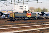 DB RAILION - 6503 -  Class 6400 diesel electric, 120 built from 1989, main freight diesel - arrives at Roosendaal with a rake of stone hoppers, 15/04/03.