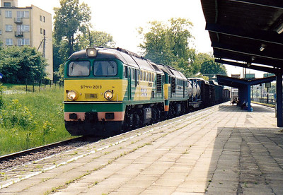 ST44 2013 and ST44 2043 rumble through Szedziszow Station with a mixed freight from Slawkow, 20/06/06. Nearly all LHS trains are doubleheaded.