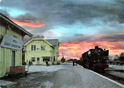 NORWAY - NSB - 3437 - an ex-German 2-10-0 'Krieglok' stands in Hell Station on a freight train as the light fades - date unknown but steam ended in Norway in the early 1970's - note the sign on the left!