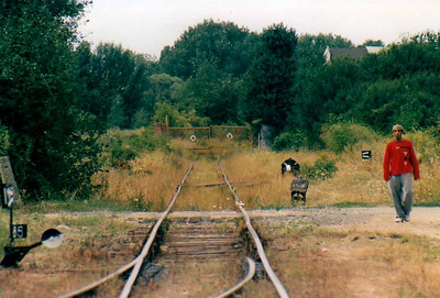 BRKS - ZAHORKSA VES - the yellow gates mark the Austrian border. This character and I were the only passengers back to Bratislava. He tried to sell me his watch, a Sekonda, within 2 minutes of saying hello and I later saw him trying to sell it to the guard. 13/08/04.