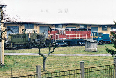 BOSANY (2) - Just north of the station is a large Army Depot, perhaps a disposal point, crammed with equipment of all descriptions, including a number of locomotives, perhaps as many as 10. It was a lousy day and I took my pictures as we passed, consequently details, such as engine numbers, are not decipherable, However, I have shown for the sake of interest. Here we see an Army-liveried Class 710, a Class 742 and a T212, 08/03/07.