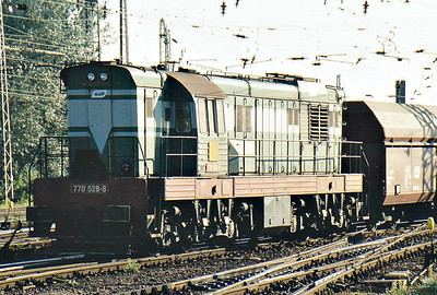 BRKS - 770 538 - 195 engines built 1968 to 1972 by SMZ for heavy shunting/trip freight duties, thousands exported, 42 on ZSR, many in industrial use - hangs on the rear of the coal train hauled by 230 065, 12/09/06. She is probably there to work the train over non-electrified sidings at the train's destination.