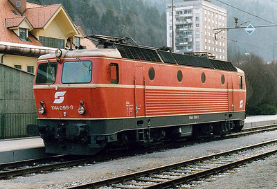 OBB - 1044 099 - 126 engines built from 1974 for mixed traffic duties - waits to collect an international train at Jesenice, 05/04/05.