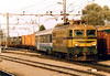 SZ - 342 005 - 40 engines built from 1968 in Italy for mixed traffic duties - departs Pragersko Yard with a long train of Italian military vehicles from the Hungarian battle training grounds at Veszprem, 27/10/04.