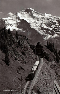 JUNGFRAUBAHN - This metre gauge rack railway that climbs 1500m over a track length of 9km, terminating at the summit of the Jungfrau at an altitude of 3454m above sea level. 80% of the track is enclosed in tunnels. Posted August 27th, 1956.