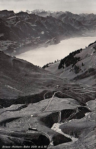 BRIENZER ROTHORN BAHN - built in 1892 and climbs 5505 feet in 4.7 miles, terminating at Rothorm Kulm, 7362 feet above sea level. The Abt rack system is employed, as on the Snowdon Mountain Railway. This is the view across the Brienzersee