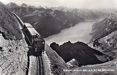 BRIENZER ROTHORN BAHN - Engine No.6 was built in 1933 and is seen here passing the Brienzerzee. The rack rail is clearly visible in the 1950's shot.