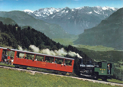 BRIENZER ROTHORN BAHN - Loco No.7 of 1936 pushes steadily uphill. Note how the sloping boiler remains horizontal on the steep grade.