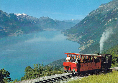 BRIENZER ROTHORN BAHN - built in 1892 and climbs 5505 feet in 4.7 miles, terminating at Rothorm Kulm, 7362 feet above sea level. The Abt rack system is employed, as on the Snowdon Mountain Railway. This is the view across the Brienzersee.