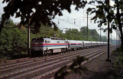 AMTRAK - 969 - a General Electric E60CH heads the 'Minute Man', Boston - Washington, at Princeton Junction, NJ, in May 1976.