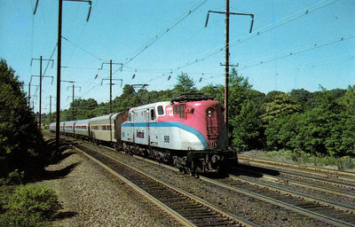 AMTRAK - 906 - Pennsylvania RR Class GG1 heads a Metroliner on the Norftheast Corridor in 1973.