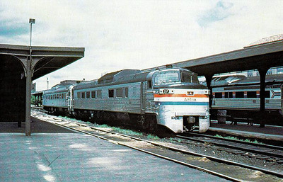 AMTRAK - 27 - a Budd railcar, formerly of the New Haven RR, awaits departure form Springfield, Mass., for Hartford, Conn., in 1979.