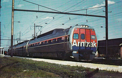 AMTRAK - 830 - lead unit of this Philadelphia - Harrisburg Metroliner train, seen here at Cotesville, Pa., in 1982.