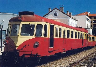 CORSICA - CFC - Railcar No.20 and trailer stand at Calvi Station, 20/08/02.
