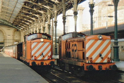 PORTUGAL - CP - 1405 - 67 Class 1400 Bo-Bo diesel electric engines built in 1967 for light passenger/freight duties - about 20 still in traffic - stands in the platform whilst 1433 awaits departure on a train.