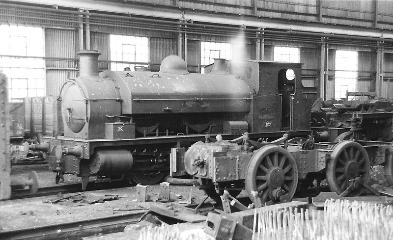 BURRY PORT & GWENDRAETH VALLEY RAILWAY - No.1 ASHBURNHAM - 0-6-0ST built 08/00 by Chapman & Furneaux Ltd. - 1922 to GWR as No.2192, name removed - 04/51 withdrawn from 87A Neath - seen here as GWR No.2192 in Works.<br /> The BP&GVR was a mineral railway constructed along the line of a canal in Carmarthenshire to connect collieries and limestone pits to the sea at Kidwelly. It extended its network to include Burry Port, Trimsaran and a brickworks at Pwll, later extending to Sandy near Llanelli. The BP&GVR was notable because of the very low height of some overbridges, a legacy of the canal conversion. It was completely dependent on the economy of the mineral industries it served and due to depression in them, it was for many years in administration. In the final years of the nineteenth century those industries developed considerably and the fortunes of the BP&GVR improved as well  before absorption by the Great Western Railway in 1922. From 1913 the Company carried the general public in passenger trains. After 1945 mineral extraction in the area declined steeply; passenger operation ceased in 1953, and in the 1960s most of the network closed progressively as pits closed. The final short section at Kidwelly closed in 1998.