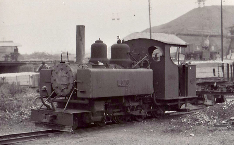 ASHOVER LIGHT RAILWAY - JOAN - 4-6-0T built 1917 by Baldwin Locomotive Works No.44720 - 1948 out of use, 1951 scrapped - seen here at Ashover.<br /> The Ashover Light Railway was a 597 mm narrow gauge railway in Derbyshire that connected Clay Cross and Ashover. It was built by the Clay Cross Company to transport minerals such as limestone, fluorite, barytes and gritstone to its works at Clay Cross. The line was 7.25 miles long and opened to goods traffic in 1924 and to passenger traffic in March 1925. The line was built using surplus equipment from the War Department Light Railways. Although the line was built principally to carry mineral traffic, its passenger service proved successful during the mid-1920s, but competition from buses saw numbers decline and passenger services were withdrawn in 1936.  The mineral traffic continued but the railway declined through the 1940's. In 1949 the railway's last remaining contract with Butts quarry was terminated and the quarry closed in 1950. The railway closed on 31 March 1950.