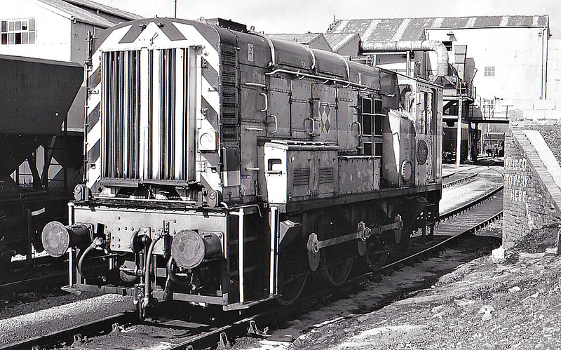 BURRY PORT & GWENDRAETH VALLEY RAILWAY - 08995 KIDWELLY - BR Class 08 0-6-0DE Shunter - built 10/59 by Horwich Works as BR No.D3854 - 02/74 to BR No.08687, 09/87 to BR No.08995 - seen here at Cwn Mawr Opencast Mine, 04/91.<br /> When steam traction ended in this region in 1965, 3 Class 03 shunters were cut down for use on the BP&GVR. These were withdrawn in 1984 and 3 Class 08's were similarly cut down for use on the line until final closure.<br /> The BP&GVR was a mineral railway constructed along the line of a canal in Carmarthenshire to connect collieries and limestone pits to the sea at Kidwelly. It extended its network to include Burry Port, Trimsaran and a brickworks at Pwll, later extending to Sandy near Llanelli. The BP&GVR was notable because of the very low height of some overbridges, a legacy of the canal conversion. It was completely dependent on the economy of the mineral industries it served and due to depression in them, it was for many years in administration. In the final years of the nineteenth century those industries developed considerably and the fortunes of the BP&GVR improved as well  before absorption by the Great Western Railway in 1922. From 1913 the Company carried the general public in passenger trains. After 1945 mineral extraction in the area declined steeply; passenger operation ceased in 1953, and in the 1960s most of the network closed progressively as pits closed. The final short section at Kidwelly closed in 1998.