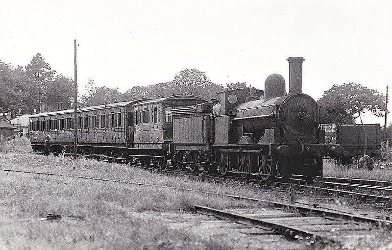 SHROPSHIRE & MONTGOMERYSHIRE LIGHT RAILWAY - No.2 - Webb LNWR Coal Engine 0-6-o - built 12/1874 by Crewe Works as LNWR No. 2167 - 01/18 to LNWR No.3563, 1924 to LMS No.8108 - 02/30 bought by SMLR, to No.2 - 12/40 SMLR taken over by Army - 11/46 withdrawn - 04/50 broken up at Swindon Works - the first vehicle in the train is the ex-LSWR Royal Coach.<br /> The Shropshire & Montgomeryshire Light Railway was a railway running from Shrewsbury to Llanymynech, Wales, opened in 1911 with a branch to Criggion. It was part of Colonel Stephens' railway empire. The line was taken over by the War Department in 1941, and extensively reconstructed to serve Central Ammunition Depot Nesscliffe. It was finally closed in 1960.