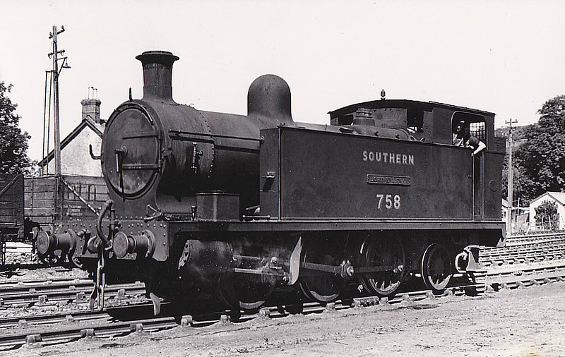 "PLYMOUTH, DEVONPORT & SOUTH WEST JUNCTION RAILWAY - No.5 LORD ST LEVEN - 0-6-2T built 1907 by Hawthorne Leslie & Co. - 1923 to SR No.758, 11/50 to BR No.30758 - No.5 stayed on the branch until September 1952 when Ivatt 2-6-2T's took over and it moved to Eastleigh on shunting duites, form where it was withdrawn in December 1956 - seen here at Callington, 10/49.<br /> The Plymouth, Devonport and South Western Junction Railway constructed a main line railway between Lydford and Devonport enabling the London and South Western Railway to reach Plymouth more conveniently than before. The line was worked by the LSWR as part of its own system. The PD&SWJR then built a branch from Bere Alston to Callington opened on March 2nd, 1908, using the new Bere Alston and Calstock Light Railway and the East Cornwall Mineral Railway which was re-gauged from 3' 6"" to standard gauge. The branch was engineered under the supervision of Colonel Stephens and it was operated independently and not by the LSWR. For this extension three steam locomotives were purchased from Hawthorn Leslie and Company. The new locomotive's livery was blue with brass dome covers and chimney caps and they were named after the company's directors. The two 0-6-2Ts were named Lord St Leven and Earl of Mount Edgecumbe and the 0-6-0T was named A S Harris. The LSWR actually absorbed the PD&SWJR just prior to the grouping and Numbers 3-5 were repainted in LSWR sage green livery and then re-numbered 756 to 758."