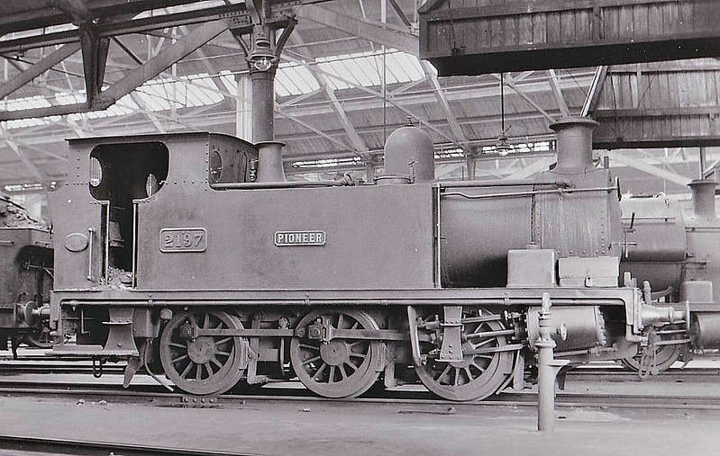 BURRY PORT & GWENDRAETH VALLEY RAILWAY - No.8 PIONEER - 0-6-0T built 03/09 by Hudswell Clarke - 1922 to GWR as No.2197 - 10/52 withdrawn from 87F Llanelli - seen here as GWR No.2197.<br /> The BP&GVR was a mineral railway constructed along the line of a canal in Carmarthenshire to connect collieries and limestone pits to the sea at Kidwelly. It extended its network to include Burry Port, Trimsaran and a brickworks at Pwll, later extending to Sandy near Llanelli. The BP&GVR was notable because of the very low height of some overbridges, a legacy of the canal conversion. It was completely dependent on the economy of the mineral industries it served and due to depression in them, it was for many years in administration. In the final years of the nineteenth century those industries developed considerably and the fortunes of the BP&GVR improved as well  before absorption by the Great Western Railway in 1922. From 1913 the Company carried the general public in passenger trains. After 1945 mineral extraction in the area declined steeply; passenger operation ceased in 1953, and in the 1960s most of the network closed progressively as pits closed. The final short section at Kidwelly closed in 1998.