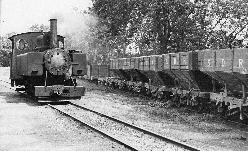 SNAILBEACH DISTRICT RAILWAY - No.3 - Baldwin WD Class 10-12-D 4-6-0T - 711mm gauge - built 1916 by Baldwin Locomotive Works, Works No,44383 for War Department - 1923 railway taken over by Colonel Stephens, two ex-WD Class 10-12-D bought - 1947 out of service - 1950 scrapped.<br /> Snailbeach District Railway was a 711mm narrow gauge railway in Shropshire. It was built in 1877 to carry lead ore from mines in the Stiperstones to Pontesbury where the ore was transhipped to the Great Western Railway's Minsterley branch line. Coal from the Pontesford coal mines travelled in the opposite direction. The line ended at Snailbeach, the location of Shropshire's largest and richest lead mine. By the end of World War One, traffic had dwindled and the line was virtually closed. In 1923, Colonel Stephens took it over and re-equipped it, traffic now being mainly stone. By 1947, all steam locomotives were out of action, loaded trains being moved by gravity, empties returned by a tractor. The line closed in 1959 and was lifted in 1961.