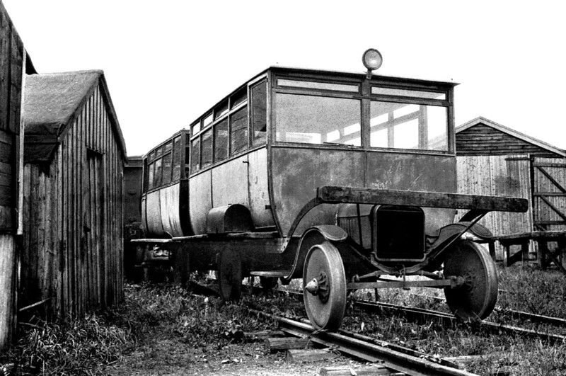 KENT & EAST SUSSEX RAILWAY - FORD RAILCARS - The railway owned two pairs of Ford railcars so I'm not sure which pair these are - I'm fairly sure they are the Ford cars. The first pair was bought in 1923 and scrapped in 1934, whilst the second was bought in 1924, withdrawn in August 1937 and scrapped in 1941 so I suspect that this may be that pair in store after withdrawal.<br />  The Kent & East Sussex Railway was opened piecemeal between 1900 and 1905. It ran between Headcorn and Robertsbridge, a distance of just over 21 miles, and was one of Colonel Stephens' railways. It never ran at a profit and became part of BR in 1948. The last passenger train ran in June 1961 and the final section closed to freight in January 1970. Since then, it has been revived by a preservation group.
