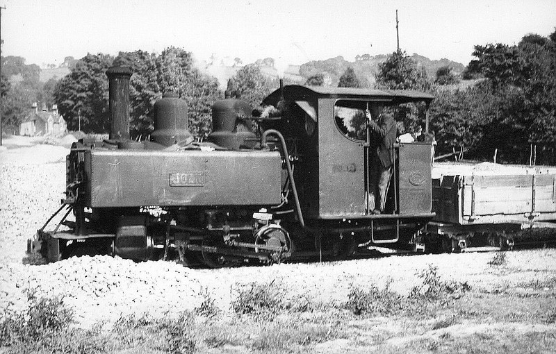 ASHOVER LIGHT RAILWAY - JOAN - 4-6-0T built 1917 by Baldwin Locomotive Works No.44720 - 1948 out of use, 1951 scrapped - seen here at Ashover Butts.<br /> The Ashover Light Railway was a 597 mm narrow gauge railway in Derbyshire that connected Clay Cross and Ashover. It was built by the Clay Cross Company to transport minerals such as limestone, fluorite, barytes and gritstone to its works at Clay Cross. The line was 7.25 miles long and opened to goods traffic in 1924 and to passenger traffic in March 1925. The line was built using surplus equipment from the War Department Light Railways. Although the line was built principally to carry mineral traffic, its passenger service proved successful during the mid-1920s, but competition from buses saw numbers decline and passenger services were withdrawn in 1936.  The mineral traffic continued but the railway declined through the 1940's. In 1949 the railway's last remaining contract with Butts quarry was terminated and the quarry closed in 1950. The railway closed on 31 March 1950.