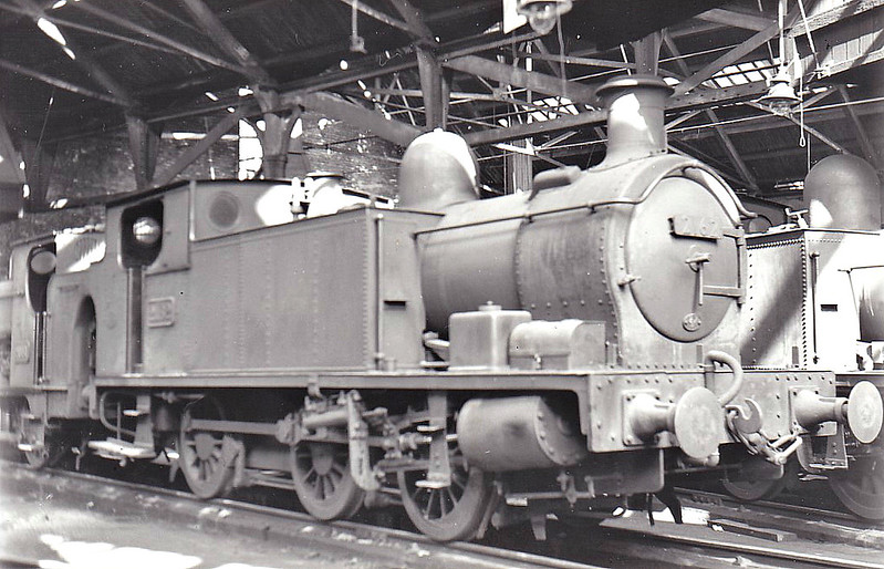 BURRY PORT & GWENDRAETH VALLEY RAILWAY - No.2 - 0-6-0T built 05/14 by Hudswell Clarke & Co. - 1922 to GWR as No.2162 - 03/55 withdrawn from 87F Llanelli, where seen as GWR No.2162.<br /> The BP&GVR was a mineral railway constructed along the line of a canal in Carmarthenshire to connect collieries and limestone pits to the sea at Kidwelly. It extended its network to include Burry Port, Trimsaran and a brickworks at Pwll, later extending to Sandy near Llanelli. The BP&GVR was notable because of the very low height of some overbridges, a legacy of the canal conversion. It was completely dependent on the economy of the mineral industries it served and due to depression in them, it was for many years in administration. In the final years of the nineteenth century those industries developed considerably and the fortunes of the BP&GVR improved as well  before absorption by the Great Western Railway in 1922. From 1913 the Company carried the general public in passenger trains. After 1945 mineral extraction in the area declined steeply; passenger operation ceased in 1953, and in the 1960s most of the network closed progressively as pits closed. The final short section at Kidwelly closed in 1998.