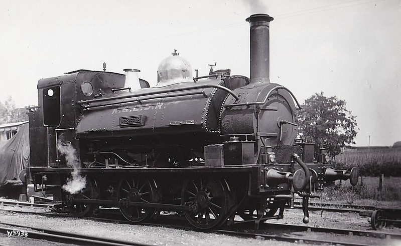 KENT & EAST SUSSEX RAILWAY - No.8 HESPERUS - 0-6-0ST built 1876 by Manning Wardle for contractors Cropper & Macauley - sold immediately to the Narberth Road and Maenclochog Railway, named RINGING ROCK - 1898 acquired by GWR - based on Goonbarrow branch - 1902 rebuilt, numbered 1380 - 11/12 sold to K&ESR - 1915 renamed HESPERUS - 02/18 derailed in floods and rebuilt with new cab - 03/39 withdrawn - 1941 scrapped - seen here after 1918 rebuild.<br /> The Kent & East Sussex Railway was opened piecemeal between 1900 and 1905. It ran between Headcorn and Robertsbridge, a distance of just over 21 miles, and was one of Colonel Stephens' railways. It never ran at a profit and became part of BR in 1948. The last passenger train ran in June 1961 and the final section closed to freight in January 1970. Since then, it has been revived by a preservation group.