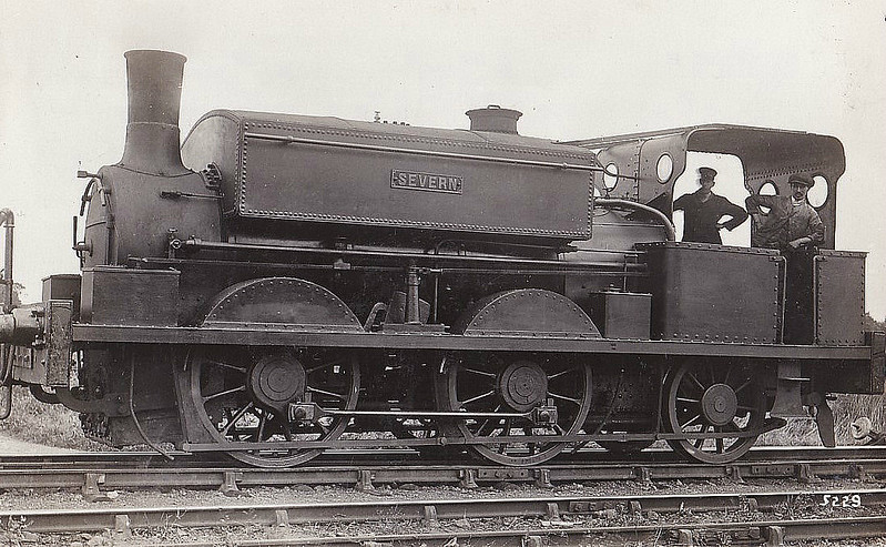 SHROPSHIRE & MONTGOMERYSHIRE LIGHT RAILWAY - No.2 SEVERN - believed to have been built as a tender engine for the St. Helens Railway in about 1853. Numbered 23 and named HERO, it passed to the L.N.W.R. as No. 1389 before being sold in 1865 to J. Cross and Company, who altered it to a side tank engine. In 1869 it became No. 2 of the Bristol Port Railway and Pier Company. When that company was taken over by the Midland and Great Western Railways in 1890, the locomotive was sold and its subsequent history is obscure until 1911, when Col. Stephens purchased it from the Grief Colliery. By then it had become an 0-4-2ST named HECATE. The name was changed to SEVERN in 1916. The loco was withdrawn during the early 1920's.<br /> The Shropshire & Montgomeryshire Light Railway was a railway running from Shrewsbury to Llanymynech, Wales, opened in 1911 with a branch to Criggion. It was part of Colonel Stephens' railway empire. The line was taken over by the War Department in 1941, and extensively reconstructed to serve Central Ammunition Depot Nesscliffe. It was finally closed in 1960.