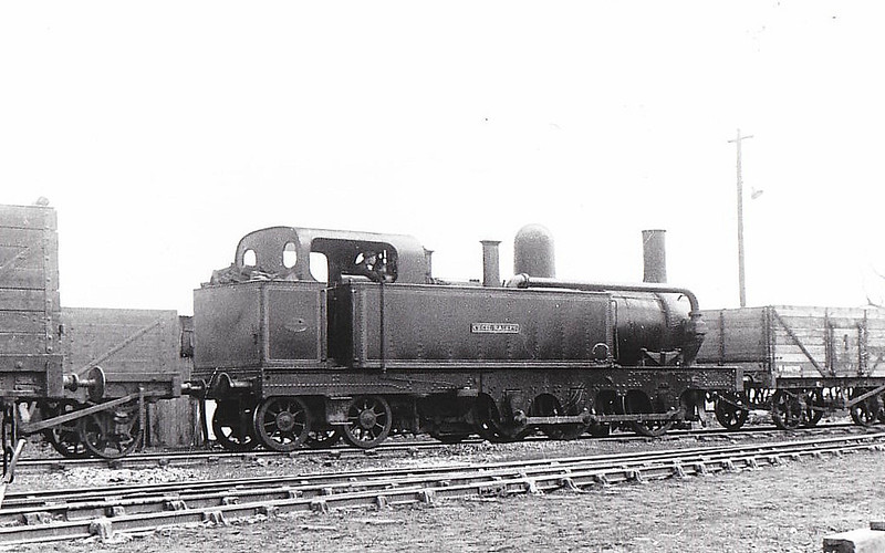 MERSEY RAILWAY - No.5 CECIL RAIKES - MR Class 1 0-6-4T - built 1886 by Beyer Peacock Ltd - 1903 sold to Shipley Collieries for £750 - 1954 withdrawn, to store at Derby Works - 1965 to Liverpool Museum - seen here at Woodside Colliery, 09/52 - note condensing gear still in place.<br /> The Mersey Railway connected Liverpool and Birkenhead, which lie on opposite banks of the River Mersey, via the Mersey Railway Tunnel from 1886 to 1948. The railway opened with four stations using steam locomotives hauling unheated wooden carriages; in the next six years the line was extended and three more stations opened. However, the steam locomotives created a polluted atmosphere in the tunnel, passengers reverted to using the river ferries and the railway was bankrupt by 1900. Recovery came after the railway adopted electric traction in 1903. The Mersey Railway remained independent in the railway grouping of 1923 but was nationalised in 1948.