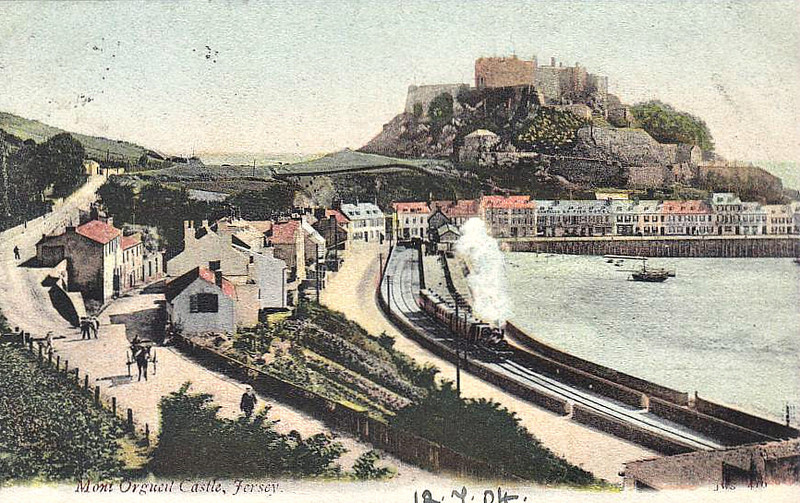 JERSEY EASTERN RAILWAY - GOREY - terminus of the Jersey Eastern Railway, 6 miles from St Helier, seen in about 1905. The line opened in 1873 to the original terminus at Grouville, whence it was extended to Gorey in May 1891 - note the very basic layout of the little station - the line closed in June 1929, put out of business by road competition - a train is leaving the station behind one of the line's 0-4-2T's, built by Kitson & Co in 1872, 1886 and 1888 -  posted on July 12th, 1904.