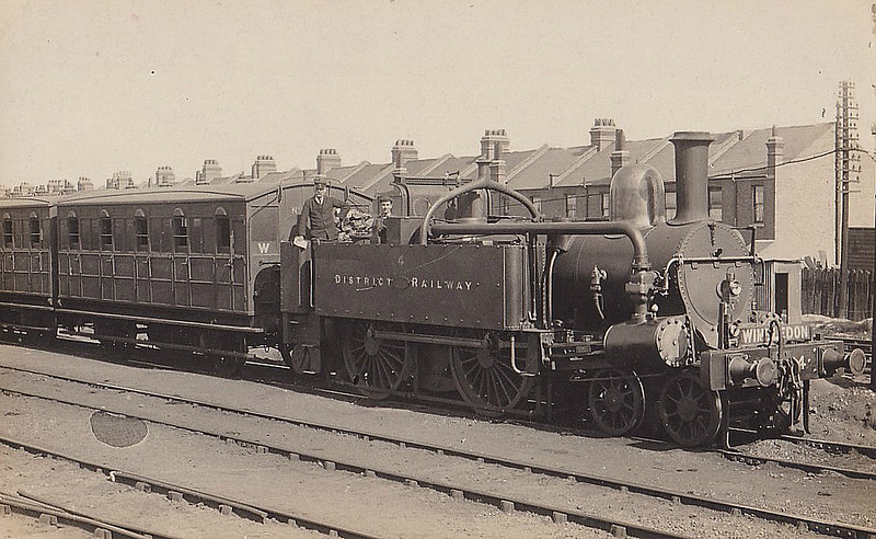 DISTRICT RAILWAY - 4 - Adams Metropolitan Railway Type 4-4-0 - built 1871 by Beyer Peacock & Co. - 1905 all engines still in service - 1907 all but 6 engines withdrawn - all withdrawn by 1933 - seen here on a Wimbledon train - note condensing gear.