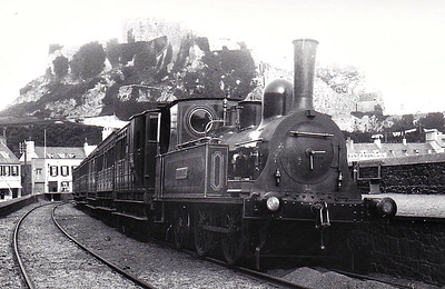 JERSEY EASTERN RAILWAY - CALVADOS - 0-4-2T - built 1872 by Kitson & Co., Works No.1833 - 06/29 withdrawn when line closed - seen here at Gorey, the terminus, with a good sized train.