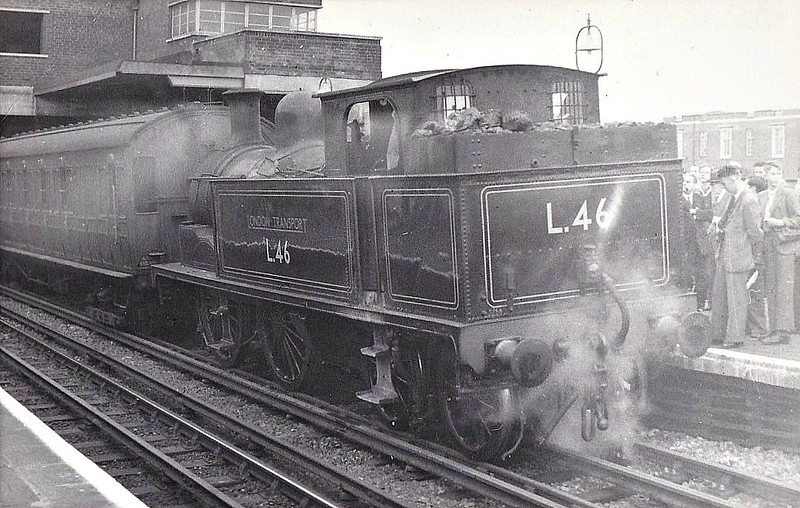 LONDON TRANSPORT - L46 - Metropolitan Railway Class E 0-4-4T - built 1896 by Neasden Works as Met. No.77 - 1962 withdrawn - seen here at Wembley Park on a 'Railway World' Hammersmith & City and Inner Circle Railtour, 22/09/57. This engine took the train from Hammersmith to Edgware Road, then to Wembley Park via Victoria and Liverpool Street.