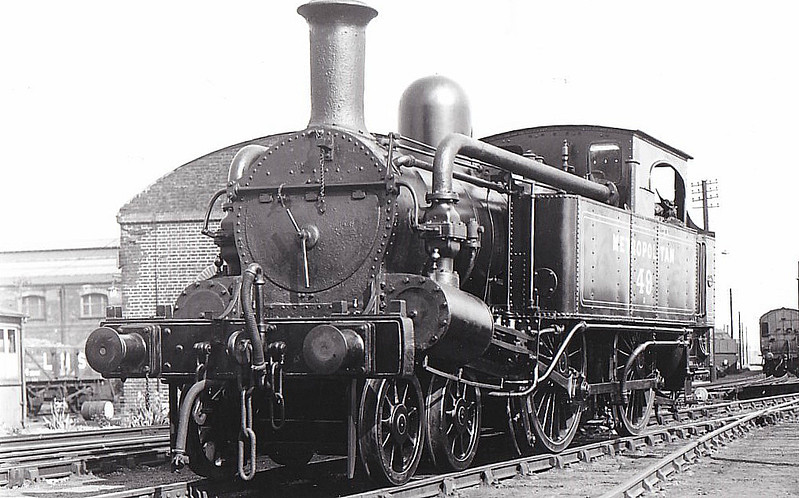 METROPOLITAN RAILWAY -  49 - A Class 4-4-0T - built 1864 by Beyer Peacock Ltd. - seen here at Neasden, 05/34 - 66 built in total - 1905/6 Metropolitan Railway electrified so most withdrawn between 1907 and 1914 - 13 retained for rural and departmental use - 1936 all steam and freight workings taken over by the LNER.