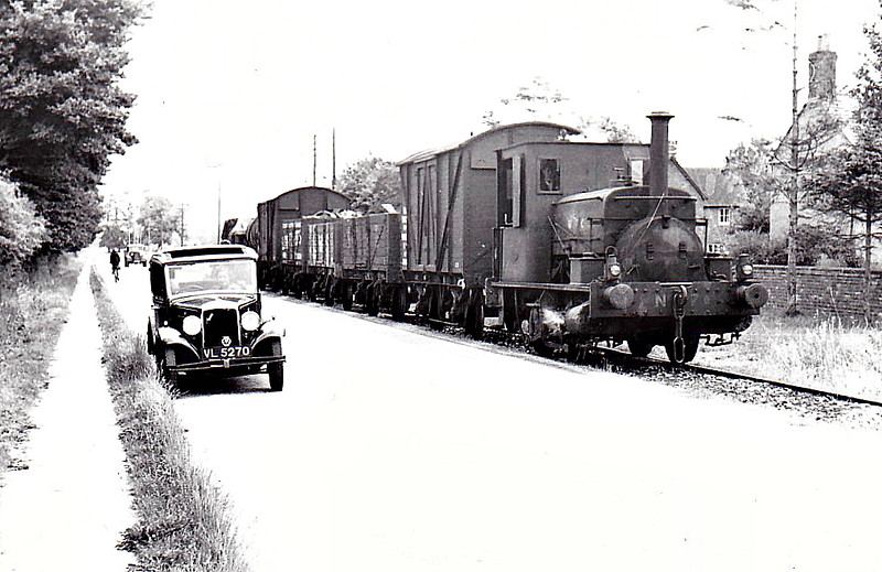 WANTAGE TRAMWAY - No.7 - 0-4-0ST - built by Manning Wardle & Co. - seen here near Wantage, 06/39. <br /> The Wantage Tramway Company was a two-mile tramway that carried passengers and freight between the Oxfordshire town of Wantage and Wantage Road Station on the Great Western Main Line. Formed in 1873 to link Wantage Road station with its terminus at Mill Street, Wantage the line was cheaply built parallel to what was then the Besselsleigh Turnpike, and now the A338. The tramway closed to passengers in 1925 and to goods traffic in 1945.