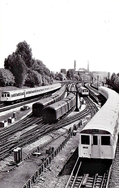 LONDON TRANSPORT - Trains of 1961-built A Stock pass either side of 2 trains of 1938-built stock at Wembley Park on the Metropolitan Line. The A Stock was only withdrawn in 2012.