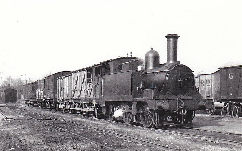 BISHOPS CASTLE RAILWAY - No.1 - 0-4-2T - ex-Great Western Railway no.567 - built 1869 by Wolverhampton Works, Works No.121 - seen here at Bishops Castle with ex-LSWR 6 wheeled brake composite, bought 1924.<br /> The Bishops Castle Railway was begun in 1861, planned as a line from Craven Arms to Montgomery, thus linking the Shrewsbury to Hereford line to the Oswestry to Newtown line, with a branch line from Lydham to Bishop's Castle. From the start, the railway was hampered by shortage of capital. Although the company continued to build, the line ultimately only reached Bishop's Castle and was sold in 1867. In January 1867, a sale by auction of property belonging to the company was held in Shrewsbury. A receiver was appointed to run the railway. The Bishops Castle Railway Company remained in receivership for 69 years and 2 months until it closed in April 1935. The line was lifted in February 1937.