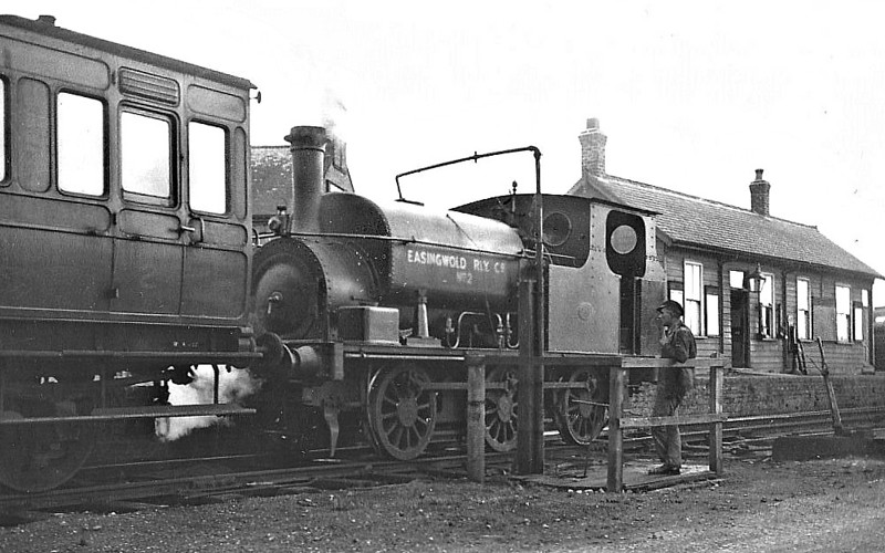 "EASINGWOLD RAILWAY - No.2 - 0-6-0ST built 05/03 by Hudswell Clarke & Co., Works No.608 - 1948 withdrawn - seen here at Easingwold Station. <br /> The Easingwold Railway was a privately owned standard-gauge railway in the Vale of York that ran from Alne Station on the East Coast Main Line to the village of Easingwold. At 2.5 miles long, the Easingwold Railway prided itself as ""England's Shortest Standard Gauge"". The line opened on July 25th, 1891, and closed on December 27th, 1957. After the scrapping of No.2, various small tank engines were hire in locally from BR."