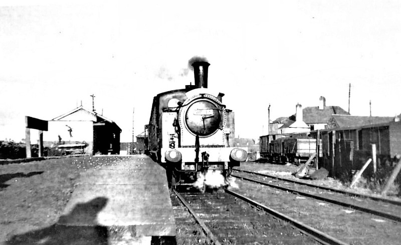 NORTH SUNDERLAND RAILWAY - 68089 - Worsdell NER Class H LNER Class Y7 0-4-0T - built 10/23 by Darlington Works as LNER No.986 - 1946 to LNER No.8089, 1948 to BR No.68089 - 01/52 withdrawn from 52A Gateshead- seen here at Seahouses on a Special, presumably just before closure - the loco was hired to the NSR between 1945 and closure. <br /> The North Sunderland Railway ran from Chathill on the ECML to the fishing village of Seahouses, just over 4 miles away. The line opened in 1898 and January 1939 was taken over by the LNER to settle large debts to the latter. Trains ceased to run on October 27th, 1951. The company only ever owned 2 engines, this one and a small diesel. Other motive power was hired in from the LNER as required.